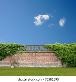 An Overgrown Wall with Balustrade and Blue Sky