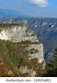 overhang of a steep mountain in Northern Italy and in the background the Asiago plateau