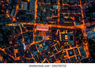 Overhead aerial drone night shot of city street lights in Lugano, Switzerland