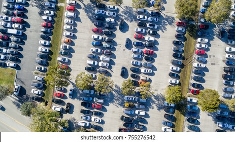 Overhead aerial view of crowded public parking. Business and shopping concept.