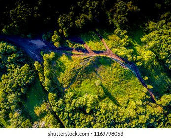 Overhead aerial view at forest dirty crossroad