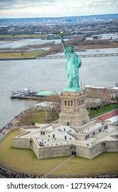 Overhead aerial view of Statue of Liberty from helicopter, New York City in winter