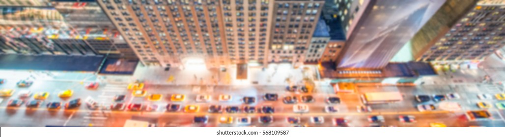 Overhead blurred night view of city traffic.