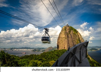 Overhead cable car approaching Sugarloaf Mountain, Guanabara Bay, Rio De Janeiro, Brazil