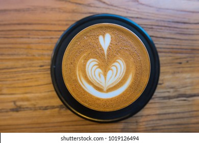 Overhead Cappucino - wooden background - Heart Shaped drink - delicious!
