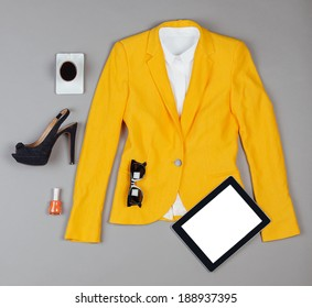 Overhead of clothes and woman accessories. / Outfit of essentials business woman on grey background.