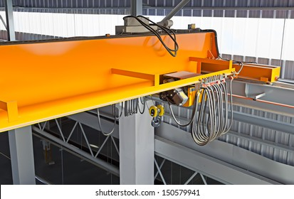 Overhead crane or bridge crane consists of parallel runways with a bridge between column also include hoist lifting and rope. Machinery for manufacturing or transportation in factory or warehouse.