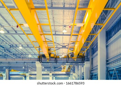 Overhead crane or bridge crane consists of parallel runways with a bridge between column also include hoist lifting and rope. Machinery for manufacturing or transportation in factory or warehouse.ing.