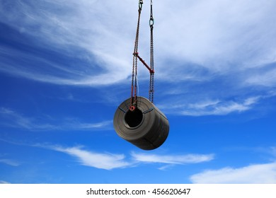 Overhead crane at port lifting heavy steel coil