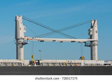 Overhead deck cranes on ship