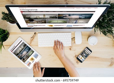 overhead desktop with e-magazine on devices screen