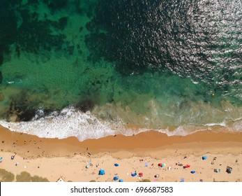 Overhead drone shot of Crystal Cove Beach in Newport Beach California