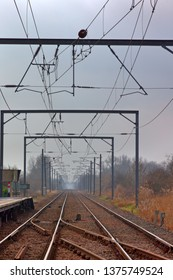Overhead electricty supply for the tains on the London to Kings Lynn line in Cambridgeshire, England, UK.