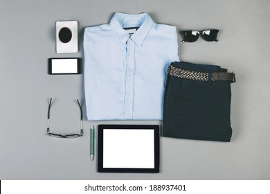 Overhead of essentials modern man./ Outfit of business man on grey background.