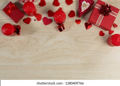 Overhead of gift boxes and heart shape decorations on wooden table