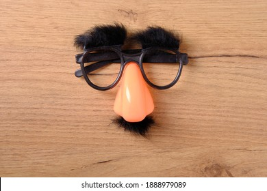 Overhead glasses with mustache, April 1, joke, fools day, top view, close-up