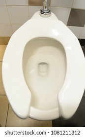Overhead image of a public restroom toilet.