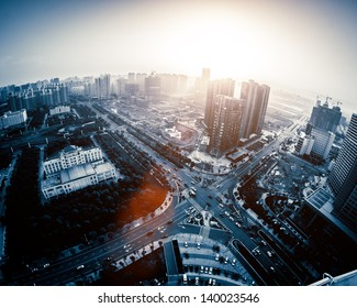 Overhead over the city, the bustling streets