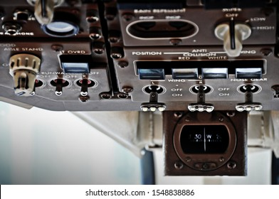 overhead panel close up in the cockpit of a commercial airplane