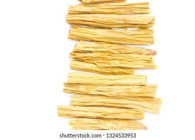 An overhead photo of dry Korean soy asparagus isolated on white. Dry Tofu skin or yuba, bean curd skin. Soy milk meal for Chinese and Japanese cuisine