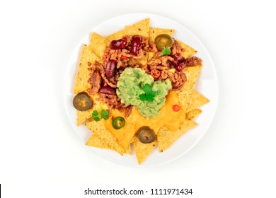 An overhead photo of nachos with cheese, chilli con carne and guacamole, traditional Mexican snack, on a white background with copy space