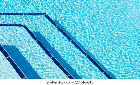 Overhead photography of ripples of water by steps in swimming pool