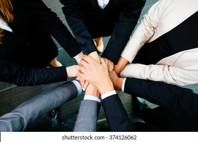 Overhead picture of business people joining hands
