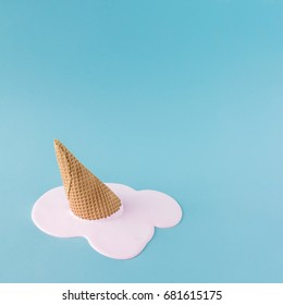 Overhead pink ice cream on pastel blue background. Minimalistic summer food concept.