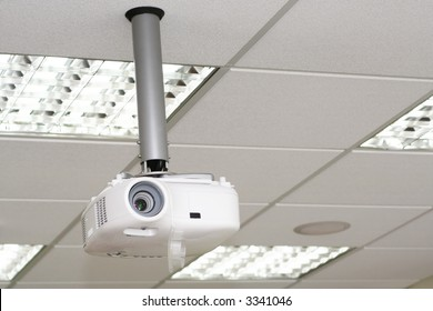 Overhead projector under the ceiling in boardroom at office