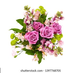 Overhead shot of a beautiful floral arrangement for Mothers Day or Valentines in a glass vase isolated on white.