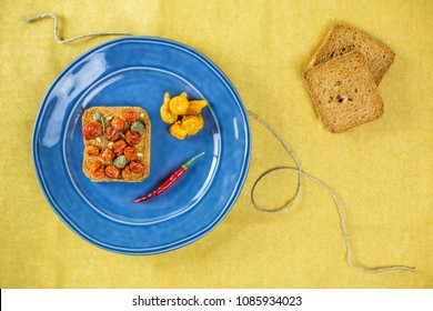 Overhead shot of brunch roasted tomato and chilli with toast bread