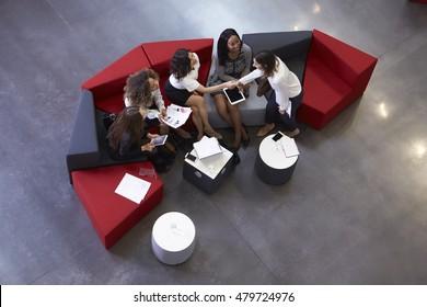 Overhead Shot Of Businesswomen Meeting In Lobby Of Office