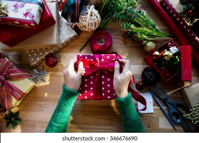 Overhead shot of Christmas presents and wrapping papers