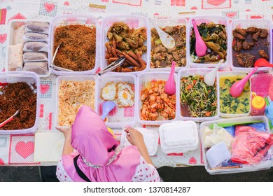 Overhead shot of delicious Malaysian home cooked dishes sold at street market stall in Kota Kinabalu Sabah.