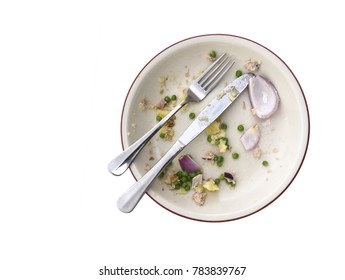 Overhead shot of an empty plate with leftovers from a meal on a white backround with copyspace