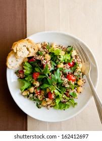 overhead shot of a fresh salad with quinoa and garbanzo beans