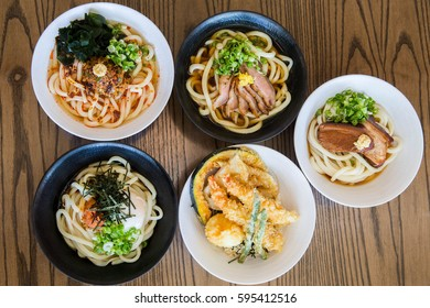 Overhead Shot of Japanese Udon Noodle Soup and Appetizers