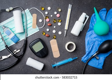 Overhead shot of medical equipment on dark stone background