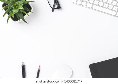 Overhead shot of office desktop with copyspace
