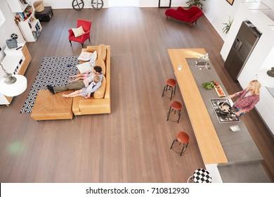 Overhead Shot Of Parents Preparing Meal Children In Kitchen