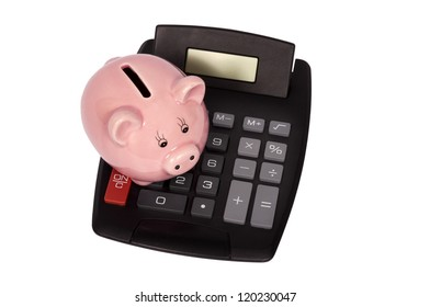 Overhead shot of piggy bank setting on top of calculator.  Isolated on white. Vertical shot.