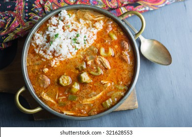 Overhead shot of a pot of gumbo with rice.