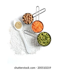 Overhead shot of pulses, chickpeas, lentils and Quinoa against a white surface. Concept image for healthy or vegetarian cooking. Copy space.