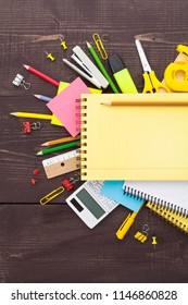 Overhead shot of school supplies on wooden background