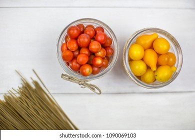Overhead shot of two bowls with cherry tomato
