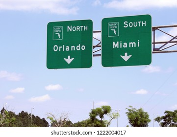 An overhead sign marking the choices of Orlando or Miami on the Florida Turnpike.