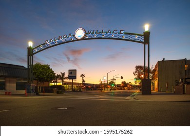 Overhead Street Sign at Entrance to Balboa Village Sunrise, tourist destination to the Fun Zone, Marina, Shops and Restaurants. Newport Beach, California, USA - January 24, 2017