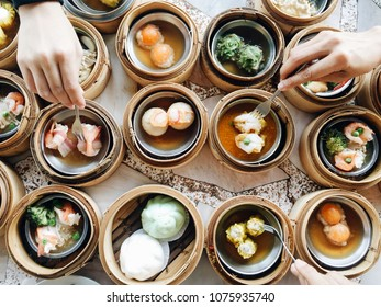 Overhead top view dim sum in chinese bamboo steamer.