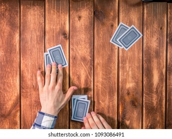 overhead top view of poker dealer on the wooden table