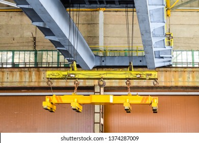 Overhead traveling crane with magnetic grippers traverse. Industrial area.